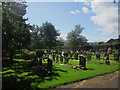 NU1912 : Graves in Alnwick Cemetery by Graham Robson