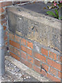 SK7954 : Bench mark, Wilson Street by Alan Murray-Rust