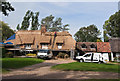 TL2966 : Rethatching at Hilton by Mick Lobb