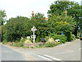 TG2439 : Northrepps village sign by Dave Fergusson