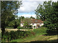 SU7990 : Houses on Moorhen Common by don cload