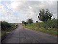 SP7518 : Straight road approaching railway bridge by John Firth