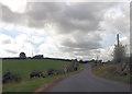 SP7312 : Main Road approaching Marsh Farm entrance by John Firth