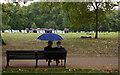 TQ2880 : Umbrella couple, Green Park by Jim Osley