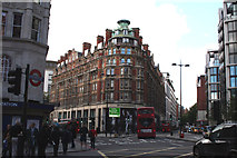 TQ2779 : Knightsbridge Corner and entrance to tube station by Dr Neil Clifton