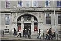 NJ9405 : Walking past the Station Hotel, Guild Street, Aberdeen by Bill Harrison