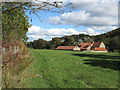 NZ1841 : House with outbuildings across field by Trevor Littlewood