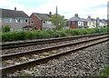 SO3205 : Newtown Road houses viewed across the railway, Penperlleni by Jaggery