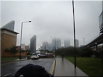 TQ3880 : View of Canary Wharf disappearing into the clouds from Blackwall Way by Robert Lamb