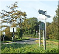 SO7502 : 3-armed signpost near Cam & Dursley railway station by Jaggery
