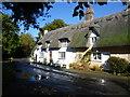 TL2379 : Thatched cottages in Wennington by Marathon