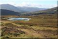 NN7266 : Maud Loch and Power Line by Anne Burgess