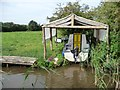 SO9161 : Small boat in a canalside boat shelter by Christine Johnstone