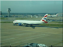 TQ2741 : Plane near air traffic control tower, Gatwick Airport by Richard Humphrey