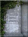 SX9373 : Pillar to flank wall, Trinity School entrance by Robin Stott