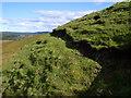 NR8257 : East bank of burn breaking through escarpment north of Cruach nam Fiadh in Kintyre by ian shiell