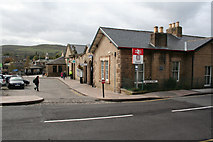 SK0394 : Glossop Station front and sign by roger geach