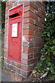 SY3493 : Benchmarked letter box on Charmouth Road by Roger Templeman