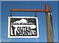 NT4423 : Outer Huntly Farm sign by Walter Baxter