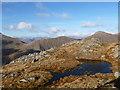 NN1440 : Small pool north-west of Beinn nan Aighenan summit by Alan O'Dowd