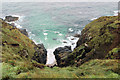 SW3835 : Cove between New Cliff and Pendeen Cliff by Stuart Logan