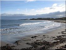 NU2424 : View across the bay to Dunstanburgh Castle by Pauline E