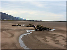 SH6214 : Cerrig-y-gorllwn rocks from the bridge by John Firth