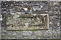 NZ1701 : Benchmarked inscribed stone in wall of Cutpurse Lane by Roger Templeman