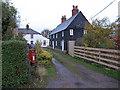 TQ9492 : Barn Row by Roger Jones