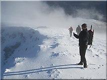 NH1462 : A hillwalker contemplates his spectre by Richard Webb
