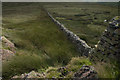 NY5505 : Drystone Wall across Crookdale Crag by Tom Richardson