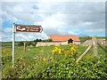 ST6517 : Sign and Barn, Oborne by Des Blenkinsopp