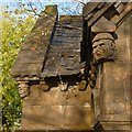 NS3979 : Smollett Mausoleum: carved heads by Lairich Rig