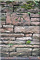 NY5439 : Benchmark on wall outside #5 Barton Dale by Roger Templeman