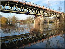 SO8455 : Worcester railway bridge reflected in floodwater by Philip Halling