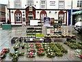 SJ9494 : Holly Wreaths outside the White Lion by Gerald England