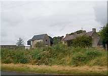 G9171 : A farm house on the N15 north of Ballybullgan by Eric Jones