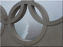 SY6774 : Chesil Beach: view through an Olympic ring by Chris Downer