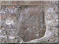 SN1121 : Inscribed stone in wall of St Tysilio's Church by chris whitehouse