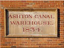 SJ9398 : Ashton Canal Warehouse Plaque by David Dixon