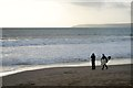 SZ0890 : Photographer and surfer on Bournemouth beach by David Lally