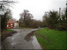 TF3686 : Stewton Lane leading into the footpath by Chris