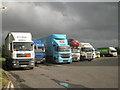 ST3552 : Trucks, M5 northbound services, Sedgemoor by Robin Stott