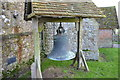 TR0434 : Bell outside Bilsington church by Julian P Guffogg