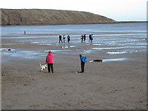 TA1280 : Midday, New Year's Day, Filey beach by Pauline E