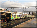 SJ7154 : London Midland train at Crewe by Stephen Craven