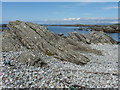 NR3593 : Isle of Colonsay: rocks and pebbles on the west coast by Chris Downer