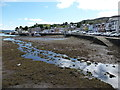 NR8668 : Tarbert: looking along the quay at low tide by Chris Downer