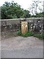 SK1242 : County boundary marker on Ellastone Bridge by Colin Park