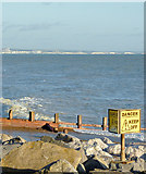 TQ1602 : Boulders and groynes near Worthing, West Sussex by Roger  Kidd